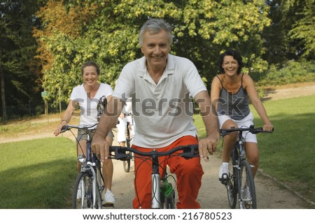 Mature adults cycling.