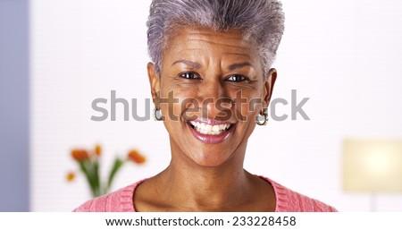 Mature African woman smiling at camera - stock photo