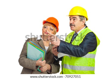 Mature architect man pointing   away and showing to his colleague woman isolated on white background - stock photo