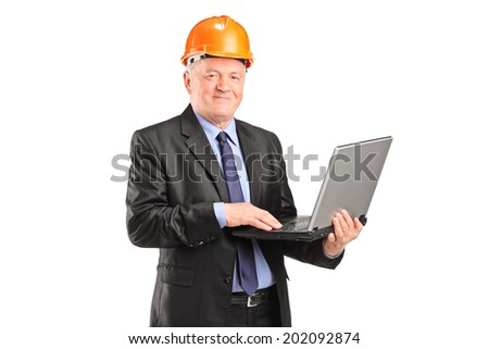 Mature architect with helmet working on a laptop isolated on white background