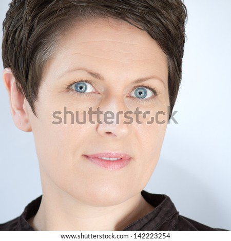 Mature attractive forty something woman close up - stock photo