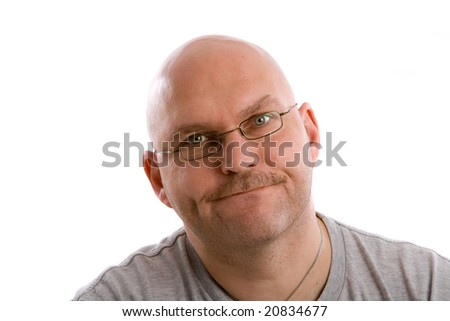 Mature balding man looking very annoyed