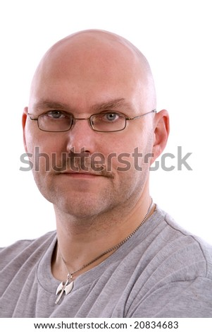 Mature balding man on white background looking serious