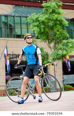 Mature bike rider in downtown - stock photo