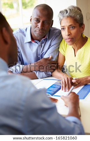 Mature Black Couple Meeting With Financial Advisor At Home - stock photo