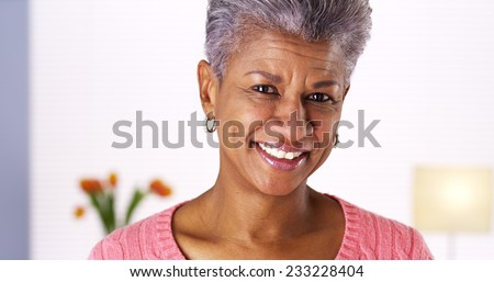 Mature black woman laughing - stock photo