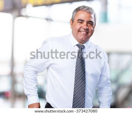mature business man holding a wallet - stock photo