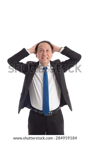 Mature business man looking up on white background isolated