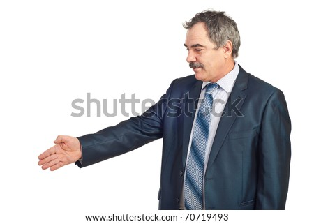 Mature business man standing in semi profile and gesturing handshake isolated on white background