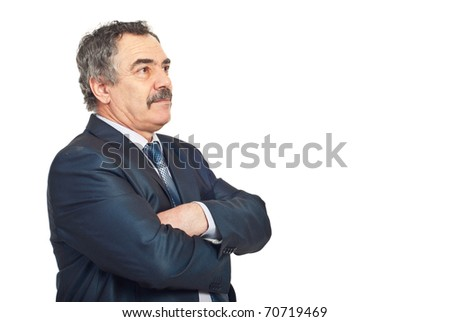Mature business man standing with hands crossed and looking away to copy space and thinking isolated on white background
