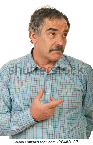 Mature business man thinking and being confuse pointing to a side isolated on white background