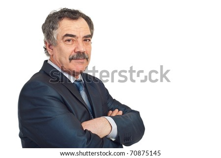 Mature business man with soft smile standing with arms folded isolated on white background,copy space for text message in right part of image