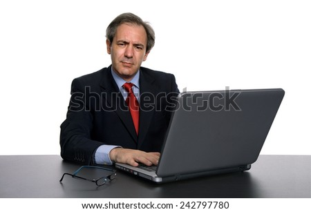 mature business man working with his laptop, isolated - stock photo
