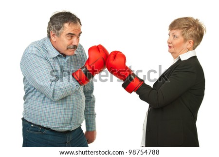 Mature business people having competition and fighting with boxing gloves isolated on white background