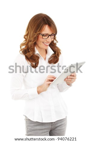 Mature business woman holding a digital touch screen tablet computer. White background. - stock photo