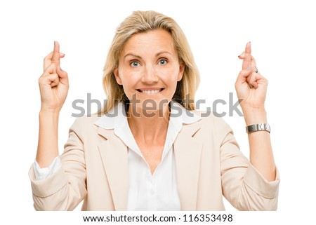 Mature business woman holding fingers crossed isolated on white background