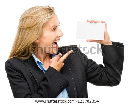 Mature business woman holding white placard pointing - stock photo