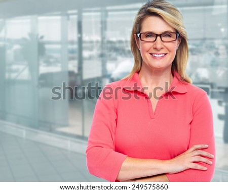Mature business woman on modern office background. - stock photo