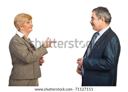 Mature business woman pointing to his colleague man and smiling isolated on white background