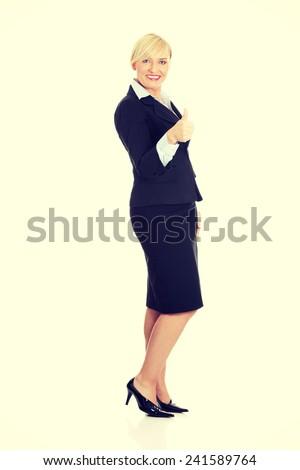 Mature business woman's gesticulating ok - stock photo