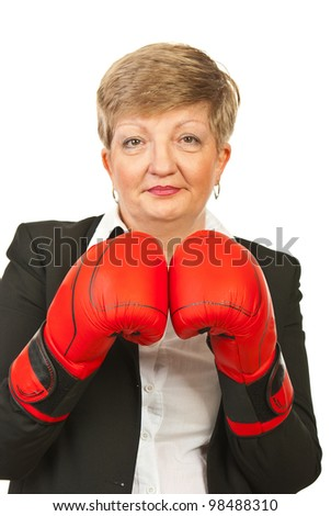 Mature business woman with boxing gloves isolated on white background