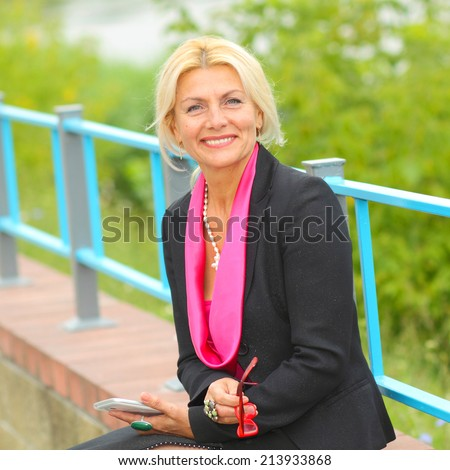 mature business woman with tablet. Smiling business woman. Outdoors. - stock photo