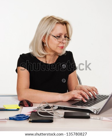 Mature business woman working in the office isolated on white background