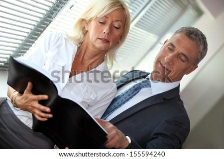 Mature businessman and businesswoman - stock photo