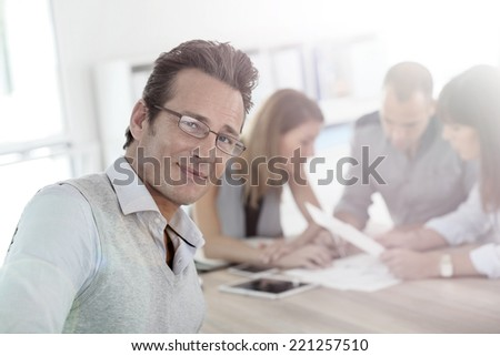 Mature businessman attending work meeting - stock photo