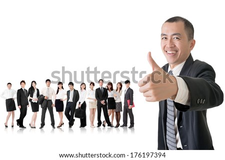 Mature businessman give you a gesture of excellent and standing in front of his team on studio white background.