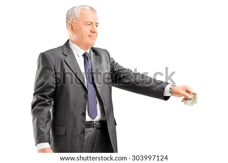Mature businessman giving money to someone isolated on white background - stock photo