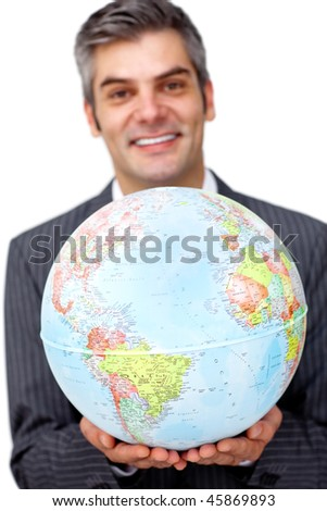 Mature businessman holding a terrestrial globe against a white background - stock photo