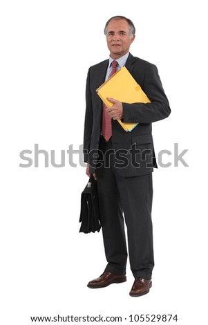 mature businessman holding folders and a briefcase