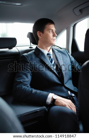 Mature businessman in the car