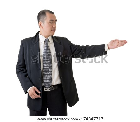 Mature businessman introduce something, closeup portrait.