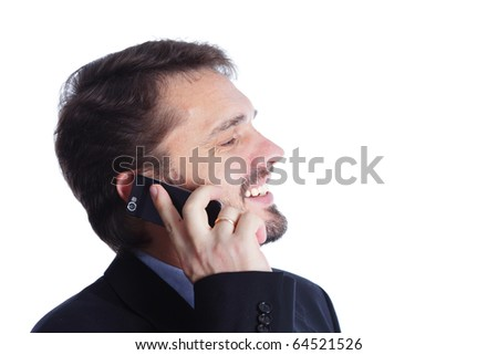 Mature businessman laughing on cellphone - stock photo