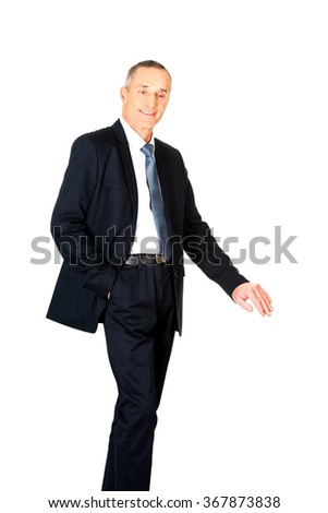 Mature businessman leaning on empty blank