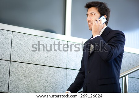 Mature businessman on the phone outdoor - stock photo