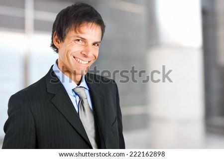Mature businessman portrait in an urban setting - stock photo