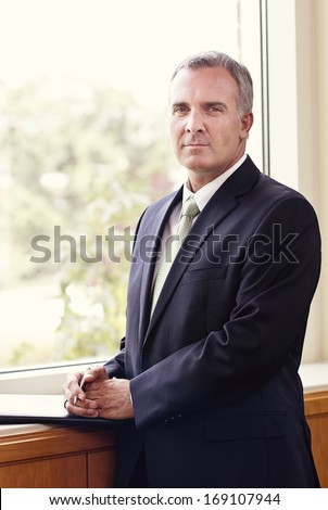 Mature Businessman Portrait vertical - stock photo