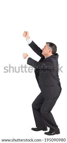Mature businessman pulling with hands on white background