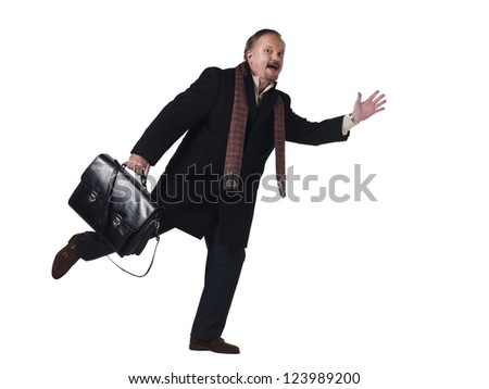 Mature businessman running with his bag against white background