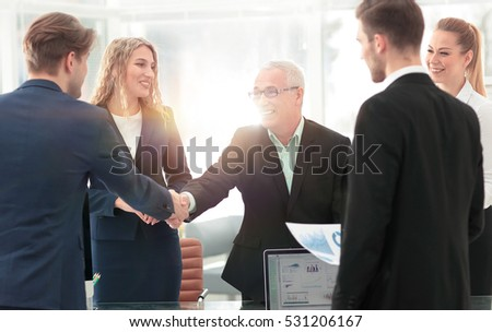 Mature businessman shaking hands to seal a deal with his partner
