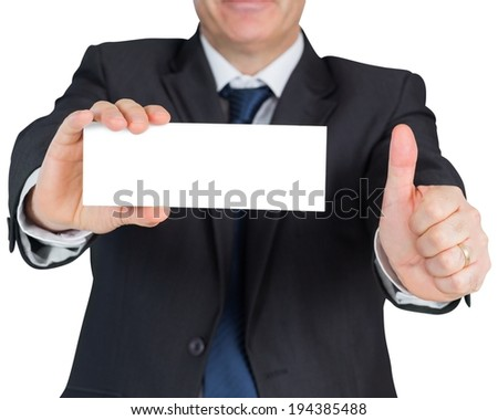 Mature businessman showing blank card on white background