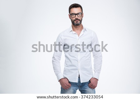 Mature businessman standing isolated on a white background and looking at camera - stock photo