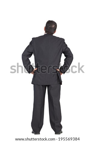 Mature businessman standing with hands on hips on white background