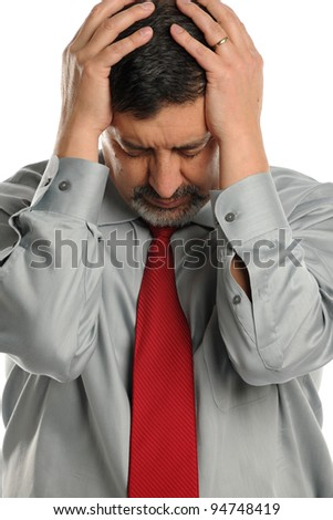 Mature businessman stressed and holding his head on a white background