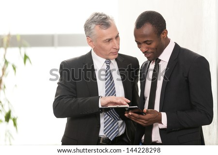 Mature businessman talking in Board Room - stock photo