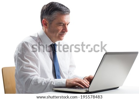 Mature businessman using his laptop on white background