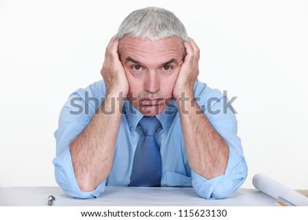 mature businessman visibly bored - stock photo